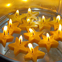Floating star-shaped candles